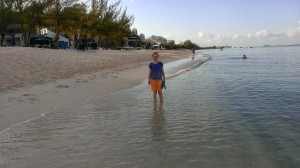 Katie's first steps in the ocean on Grand Cayman